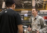 Tech. Sgt. Sean Slusarczyk, an Air Force Reserve recruiter based in Duluth, Ga., right, talks with a student from the Aviation Institute of Maintenance school in a hangar at Dobbins Air Reserve Base, Ga. June 23, 2017. Recruiters and faculty members partnered to create an opportunity for students to explore the Air Force Reserve as a possible career path upon graduation. (U.S. Air Force photo/Staff Sgt. Andrew Park)