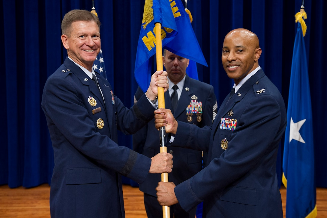 Brig. Gen. Wayne Monteith, 45th Space Wing commander, presents Col. Kevin L. Williams, 45th Mission Support Group commander, with a guidon during a change of command ceremony June 16, 2017, at Patrick Air Force Base, Fla. Changes of command are a military tradition representing the transfer of responsibilities from the presiding official to the upcoming official. (U.S. Air Force photo by Phil Sunkel)