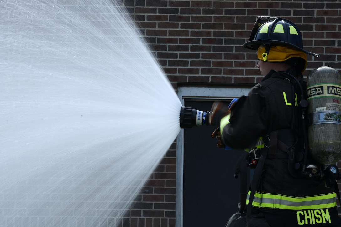 Airman Shyanne Chism, 19th Civil Engineer Squadron Fire Department firefighter apprentice, inspects a firehose June 26, 2017, at Little Rock Air Force Base, Ark. Little Rock AFB firefighters train regularly to ensure they are prepared to respond to any emergency. (U.S. Air Force photo by Airman 1st Class Kevin Sommer Giron)