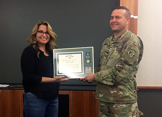 Heidi Simko, a regulatory assistant for the U.S. Army Corps of Engineers Sacramento District, is presented the Commander's Award from Col. David Ray, Sacramento District commander on May 24, 2017. Simko was named District Regulator of the Year for 2016, earning the Randy Snyder Regulatory Excellence Award.