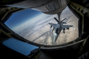 An Air Force F-16 Fighting Falcon receives fuel from a 340th Expeditionary Air Refueling Squadron KC-135 Stratotanker during a flight to support Operation Inherent Resolve over an undisclosed location, June 20, 2017. The unit delivers fuel to U.S. and coalition forces, enabling a 24/7 presence in the U.S. Central Command area of responsibility. Air Force photo by Staff Sgt. Trevor T. McBride