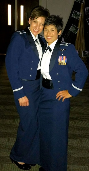 Then, 1st Lt. Heather Bradley and Capt. Maria-Rocio Vazquez pose for a photo at an awards ceremony at Travis Air Force Base, Calif. Bradley and Vazquez married in 2015. (Courtesy Photo)