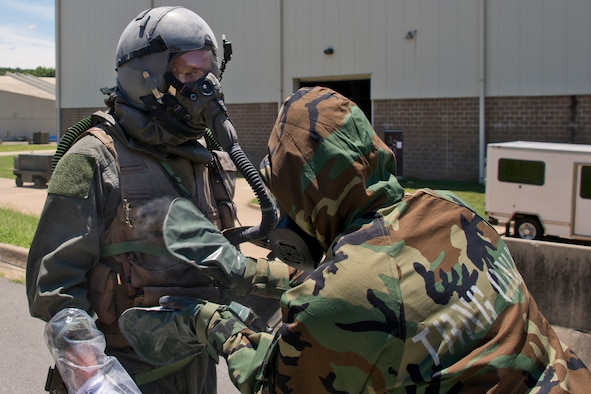 U.S. Air Force Reserve Staff Sgt. Casey Godwin, aircrew flight equipment (AFE) specialist, 327th Operations Support Squadron, pats down Staff Sgt. Michael Hopson, loadmaster, 327th Airlift Squadron, with activated charcoal from a M295 Individual Decontamination Kit during a training scenario June 19, 2017, at Little Rock Air Force Base, Ark. The training required the construction of several Lightweight Inflatable Decontamination Systems (LIDS) shelters and the removal of simulated contaminants from three aircrew members. (U.S. Air Force photo by Master Sgt. Jeff Walston/Released)