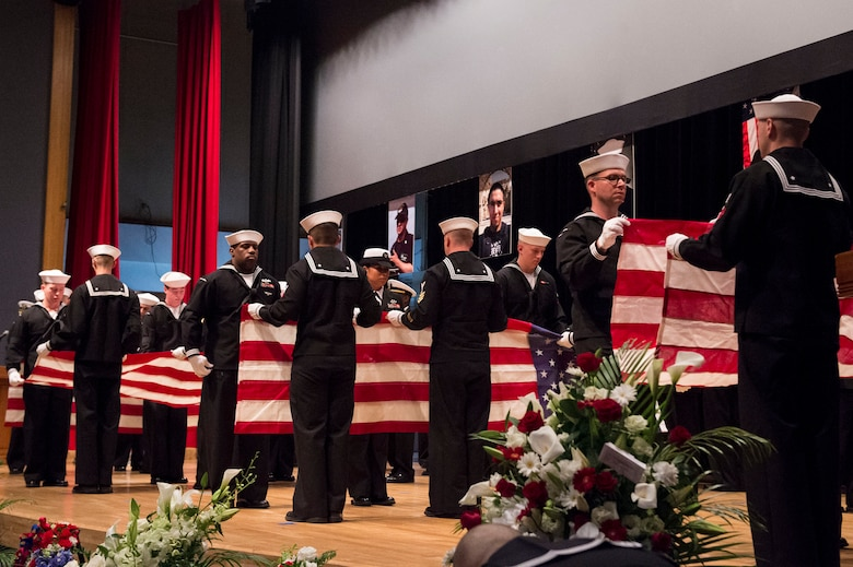 YOKOSUKA, Japan (June 27, 2017) Sailors ceremonially fold seven American flags during a memorial ceremony at Fleet Activities (FLEACT) Yokosuka for seven Sailors assigned to Arleigh Burke-class guided-missile destroyer USS Fitzgerald (DDG 62) who were killed in a collision at sea, June 17. (U.S. Navy photo by Mass Communication Specialist 2nd Class Raymond D. Diaz III/Released)