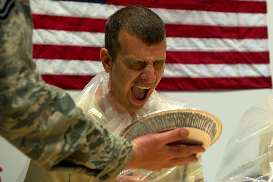 U.S. Air Force Lt. Col. Joshua Kubacz, 52nd Operations Support Squadron commander, smiles before receiving a pie in the face during the commander's parachute shop familiarization tour at Spangdahlem Air Base, Germany, June 23, 2017. Airman from the 52nd OSS aircrew flight equipment section, demonstrated how to pack parachutes to leadership before having them compete with each other to avoid a pie to the face. (U.S. Air Force photo by Senior Airman Preston Cherry)