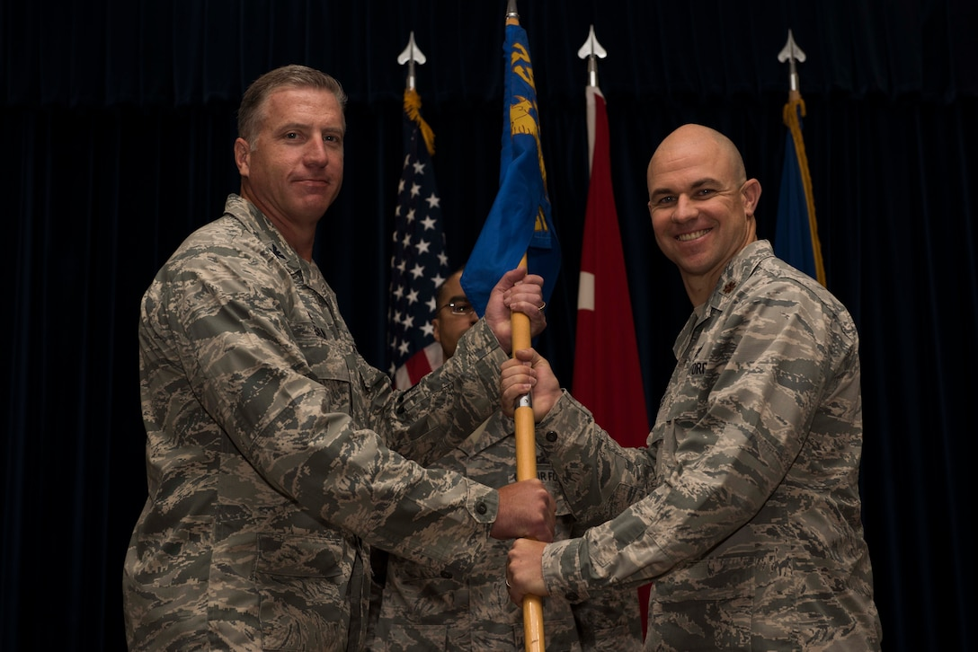 U.S. Air Force Maj. Tyler Hess (right), 39th Comptroller Squadron incoming commander, assumes command from Col. David Eaglin, 39th Air Base Wing commander, June 26, 2017, at Incirlik Air Base, Turkey. A change of command ceremony is a tradition that represents a formal transfer of authority and responsibility from the outgoing commander to the incoming commander. (U.S. Air Force photo by Airman 1st Class Devin M. Rumbaugh)