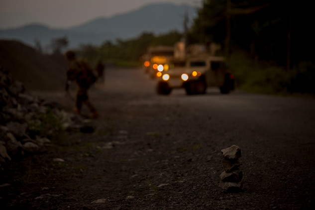 U.S. Marines assigned to Marine Wing Support Squadron (MWSS) 171, based out of Marine Corps Air Station Iwakuni, Japan, discover a potential improvised explosive device while on a security patrol during exercise Eagle Wrath 2017 at Combined Arms Training Center Camp Fuji, Japan, June 16, 2017. Eagle Wrath 2017 is a two-week training evolution focusing on air base ground defense, establishing forward operating bases and forward arming and refueling points in an austere environment as a way to support Marine Aircraft Group 12. (U.S. Marine Corps photo by Lance Cpl. Stephen Campbell)
