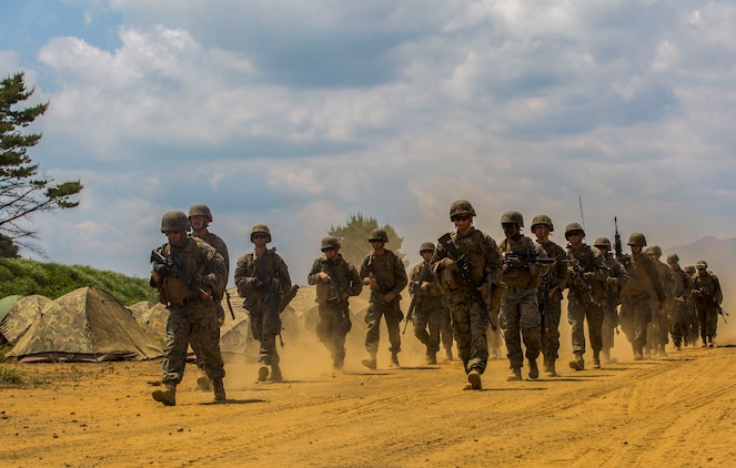 U.S. Marines assigned to Marine Wing Support Squadron (MWSS) 171, based out of Marine Corps Air Station Iwakuni, conduct a security patrol during exercise Eagle Wrath 2017 at Combined Arms Training Center Camp Fuji, Japan, June 17, 2017. Eagle Wrath 2017 is a two-week training evolution focusing on air base ground defense, establishing forward operating bases and forward arming and refueling points in an austere environment as a way to support Marine Aircraft Group 12. (U.S. Marine Corps photo by Lance Cpl. Stephen Campbell)