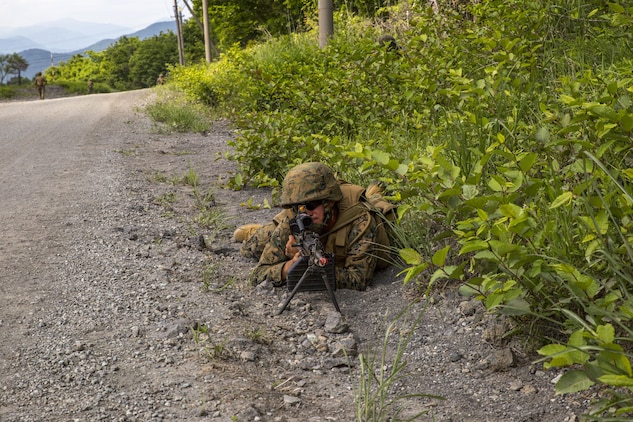 U.S. Marine Corps Lance Cpl. Christopher O'Neal, an expeditionary airfield systems technician with Marine Wing Support Squadron (MWSS) 171, based out of Marine Corps Air Station Iwakuni, posts forward security after a security patrol finds a potential improvised explosive device during exercise Eagle Wrath 2017 at Combined Arms Training Center Camp Fuji, Japan, June 17, 2017. Eagle Wrath 2017 is a two-week training evolution focusing on air base ground defense, establishing forward operating bases and forward arming and refueling points in an austere environment as a way to support Marine Aircraft Group 12. (U.S. Marine Corps photo by Lance Cpl. Stephen Campbell)