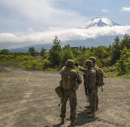 U.S. Marines assigned to Marine Support Squadron (MWSS) 171, based out of Marine Corps Air Station Iwakuni, identify a potential improvised explosive device while on a security patrol during exercise Eagle Wrath 2017 at Combined Arms Training Center Camp Fuji, Japan, June 17, 2017. Eagle Wrath 2017 is a two-week training evolution focusing on air base ground defense, establishing forward operating bases and forward arming and refueling points in an austere environment as a way to support Marine Aircraft Group 12. (U.S. Marine Corps photo by Lance Cpl. Stephen Campbell)