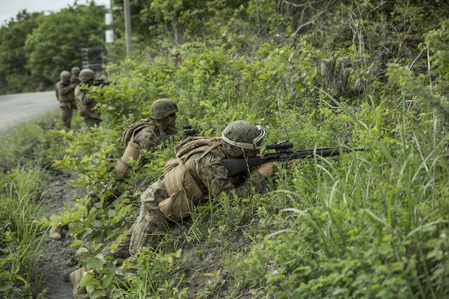 U.S. Marines assigned to Marine Wing Support Squadron (MWSS) 171, based out of Marine Corps Air Station Iwakuni, provide security during a patrol while participating in exercise Eagle Wrath 2017 at Combined Arms Training Center Camp Fuji, Japan, June 17, 2017. Eagle Wrath 2017 is a two-week training evolution focusing on air base ground defense, establishing forward operating bases and forward arming and refueling points in an austere environment as a way to support Marine Aircraft Group 12. (U.S. Marine Corps photo by Lance Cpl. Stephen Campbell)