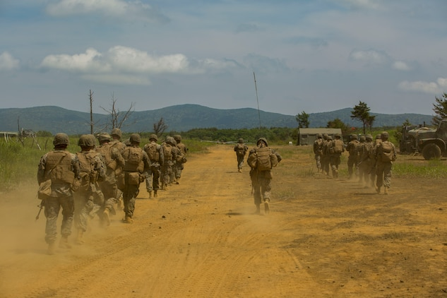 U.S. Marines assigned to Marine Wing Support Squadron (MWSS) 171, based out of Marine Corps Air Station Iwakuni, go out on a security patrol during exercise Eagle Wrath 2017 at Combined Arms Training Center Camp Fuji, Japan, June 17, 2017. Eagle Wrath 2017 is a two-week training evolution focusing on air base ground defense, establishing forward operating bases and forward arming and refueling points in an austere environment as a way to support Marine Aircraft Group 12. (U.S. Marine Corps photo by Lance Cpl. Stephen Campbell)