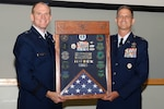 Air Force Brig. Gen. Martin Chapin, DLA Energy commander, presents a shadow box to Col. Glenn Chadwick, DLA Troop Support Industrial Hardware director, at Chadwick's retirement ceremony June 22. Chadwick served more than 27 years in the Air Force.