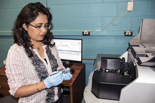 Air Force Research Laboratory research materials engineer Dr. Dhriti Nepal of the AFRL Composites Performance team performs nano-IR characterization of a nanocomposite material in the microscopy laboratory. (U.S. Air Force photo/David Dixon)