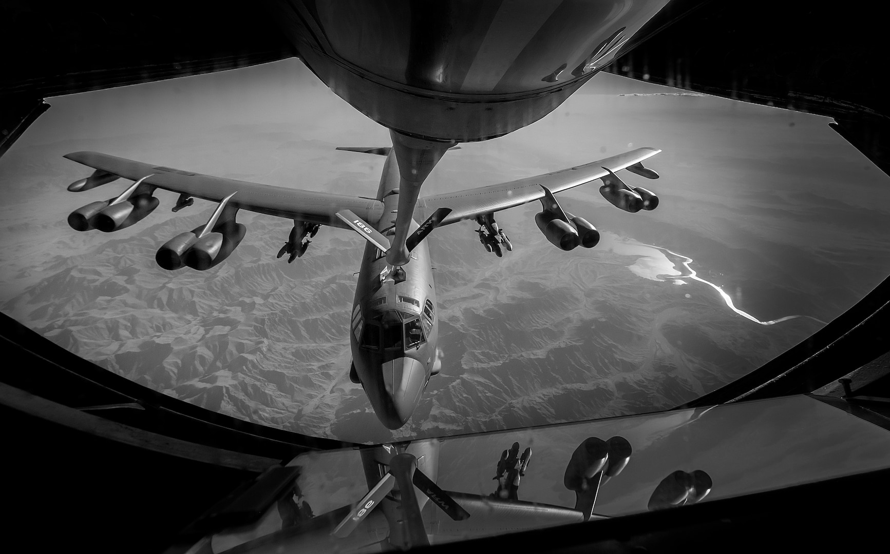 A U.S. Air Force B-52 Stratofortress receives fuel from a 340th Expeditionary Air Refueling Squadron KC-135 Stratotanker during a flight in support of Operation Resolute Support June 6, 2017. The 340th EARS, part of U.S. Air Forces Central Command, is responsible for delivering fuel for U.S. and coalition forces, enabling a persistent 24/7 presence in the area of responsibility. (U.S. Air Force photo by Staff Sgt. Trevor T. McBride)