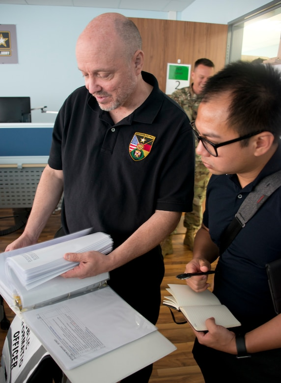 Capt. Jeku Arce (right), 221st Public Affairs Detachment Commander, goes over the public affairs tasks during an active shooter scenario with Stefan Alford, Director of Public Affairs at U.S. Army Garrison Rhineland-Pfalz, during Warrior Response 17 on June 24 in Kaiserslautern, Germany (U.S. Army photo by Richard Bumgardner).