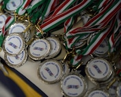 Medals lay on a table during a Special Olympics event award ceremony in Cantania, Sicily, June 7, 2017. The event was planned by Airmen deployed to the 324th Expeditionary Reconnaissance Squadron and had more than 60 children participate. (U.S. Air Force photo by Senior Airman Jimmie D. Pike)