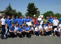 Sicilians and Airmen deployed to the 324th Expeditionary Reconnaissance Squadron pose for a picture before a Special Olympics event in Catania, Sicily, June 7, 2017. More than 40 deployed Airmen helped to plan, coordinate, set-up, and run the event for children with disabilities. (U.S. Air Force photo by Senior Airman Jimmie D. Pike)