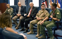 """Dan Sitterly (center), the acting Assistant Secretary of the Air Force for Manpower and Reserve Affairs, moderates while Air Force members from the """"Real Airmen, Real Stories"""" panel describe their jobs and share individual stories of heroism to a group of writers during the Air Force's third annual Magazine Day at the Pentagon in Washington, D.C., June 21, 2017. (U.S. Air Force photo/Wayne A. Clark)"""