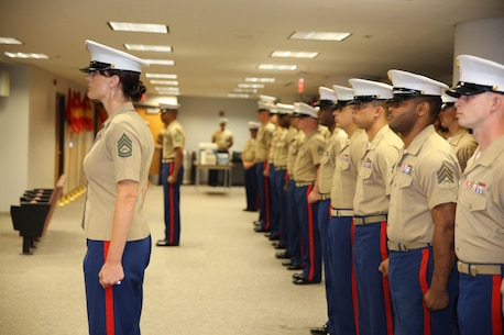 Marines from Recruiting Station St. Louis pass the command organizational colors during a change of command ceremony at Marine Corps Recruiting Station St. Louis, St. Louis, Mo. on June 23, 2017. Major Nicole Bastian took command of the recruiting station relieving Maj. Ian Duncan. (USMC Photo by Cpl. Zachery B. Martin)