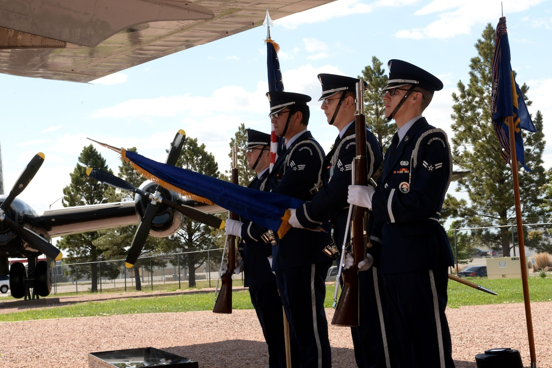 Honor Guard members from Ellsworth Air Force Base, S.D., present the colors during a memorial dedication and anniversary event at the South Dakota Air and Space Museum, Box Elder, S.D., June 24, 2017. The mission of the Ellsworth Honor Guard is to act as representatives for Airmen to both the American public and the world. (U.S. Air Force photo by Staff Sgt. Hailey Staker)