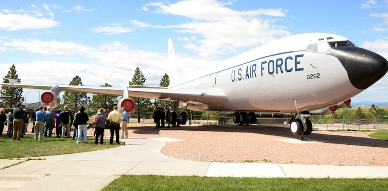"Members of the 4th Airborne Command Control Squadron attend a memorial dedication during the 25th anniversary of the deactivation of the 4th ACCS at the South Dakota Air and Space Museum, Box Elder, S.D., June 24, 2017. A bench displaying images of the EC-135 was dedicated to those who served in the squadron and have passed away. The bench sits on the museum grounds under tail 262, nicknamed ""Too Sick to Fly."" (U.S. Air Force photo by Staff Sgt. Hailey Staker)"