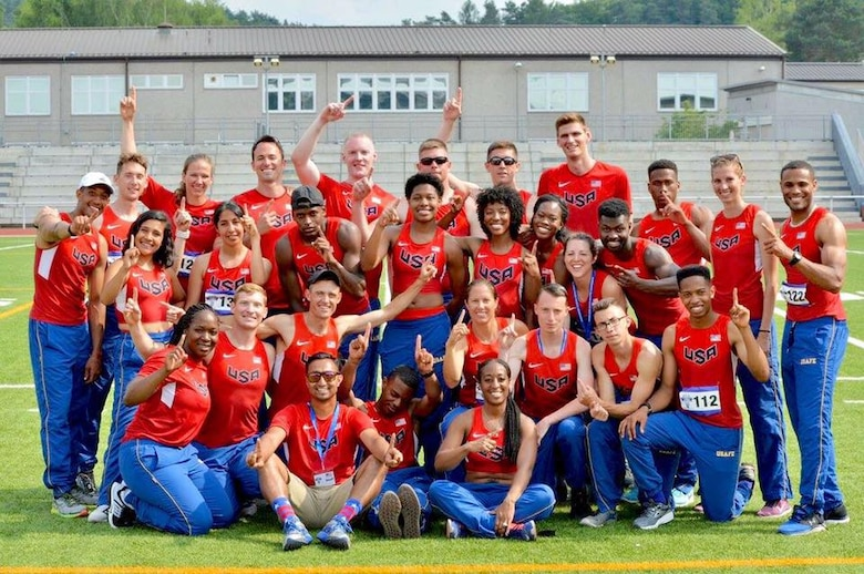Athletes representing the U.S. Air Force pose for a team photo after the conclusion of the Allied Air Command Inter-Nation Athletics Championship on Vogelweh Military Complex, Germany, June 21, 2017. Both the men's and women's teams for the U.S. won over six other countries' representatives to take first place in the competition. (Photo courtesy of Staff Sgt. Emesh Fernando)