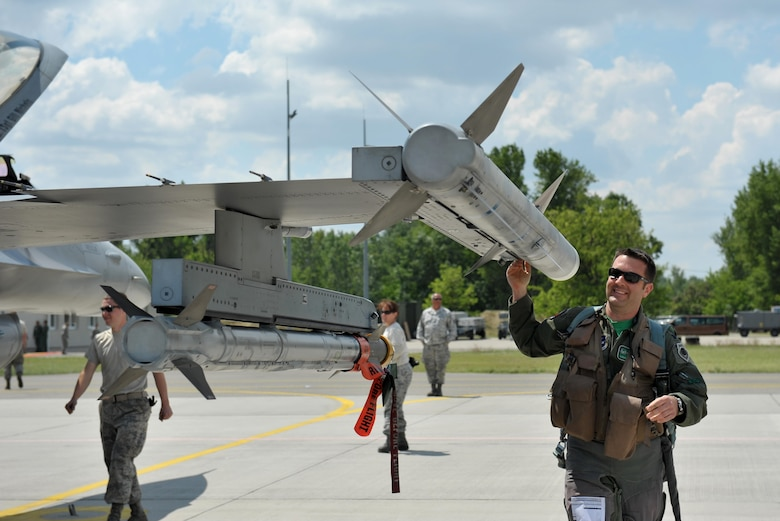 Lt. Col. Gregory Barasch, an F-16 Fighting Falcon pilot assigned to the 180th Fighter Wing, Ohio Air National Guard, conducts a preflight inspection prior to a morning sortie, May 25, 2017, at Kecskemet Air Base in Hungary. Approximately 150 Airmen and eight F-16 fighter jets from the 180FW traveled to the air base to participate in Load Diffuser 17, a two-week Hungarian-led multinational exercise focused on enhancing interoperability capabilities and skills among NATO allied and European partner air forces by conducting joint operations and air defenses to maintain joint readiness, while also bolstering relationships within the U.S. Air National Guard's State Partnership Program initiatives. Ohio became state partners with Hungary in 1993. Air National Guard photo by Senior Master Sgt. Beth Holliker.