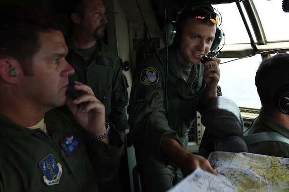 U.S. Air Force Chief Master Sgt. Randy Nelson (left), Hungarian Air Force Maj. Bela Torma (middle left), and Hungarian Air Force Lt. Lajos Halmi (right), both Hungarian AN-26 Antonov pilots, communicate with the two U.S. Air Force pilots during a C-130 flight, orienting them to the Ohio Air National Guard's 179th Airlift Wing flying mission during Exercise Load Diffuser in Kecskemet, Hungary, on June 6. The exercise is the first Load Diffuser Exercise in Hungary in seven years and only the third of its kind in the two-decade State Partnership between Hungary and the Ohio National Guard.