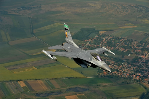An F-16 Fighting Falcon assigned to the 180th Fighter Wing, Ohio Air National Guard, flies over the skies of Hungary, June 6, 2017. More than 400 military members from six countries participated in exercise Load Diffuser 17 at the Hungarian Air Base from May 22 to June 9, 2017. Load Diffuser is a Hungarian Air Force-led, multinational flying exercise between NATO allies and partner nations. Multinational training engagements such as these strengthen our relationships, help us maintain joint readiness and interoperability, and reassure our European allies and partners. The U.S. and Hungary, as NATO allies, share a commitment to promote peace and stability, and seek opportunities to continue developing their relationship. The U.S. and Europe must preserve our mutual commitment and trust as we face emerging malignant forces and evolving strategic assets. Air National Guard photo by Senior Master Sgt. Beth Holliker.