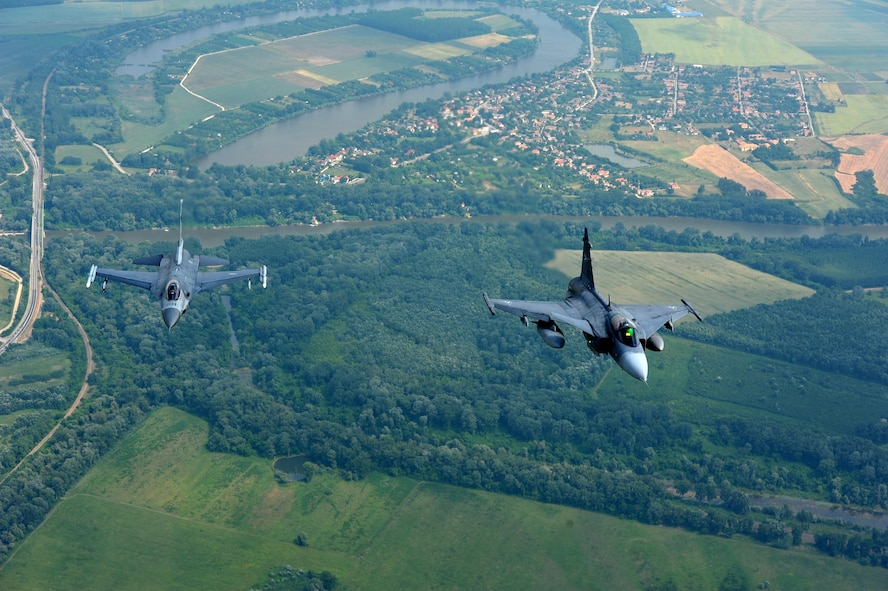 An F-16 Fighting Falcon assigned to the 180th Fighter Wing, Ohio Air National Guard, flies alongside a Hungarian JAS 39 Grippens during exercise Load Diffuser 17 at Kecskemet Air Base, Hungary, May 25, 2017. More than 150 Airmen from the 180FW and eight F-16s are participating in the Hungarian led, two week multinational exercise focused on enhancing interoperability capabilities and skills among NATO allied and European partner air forces by conducting joint operations and air defenses to maintain joint readiness, while also bolstering relationships within the U.S. Air National Guard's State Partnership Program initiatives. Ohio became state partners with Hungary in 1993. Air National Guard photo by Senior Master Sgt. Beth Holliker.