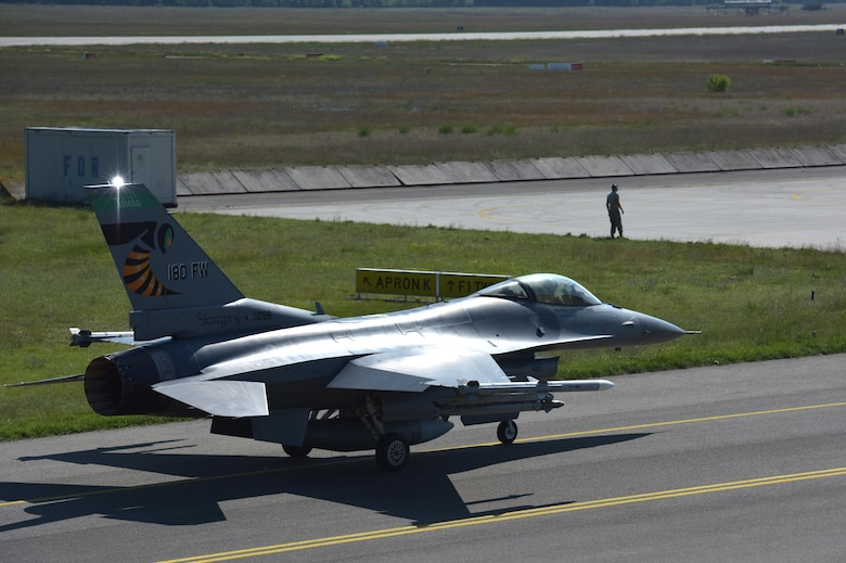 An F-16 Fighting Falcon assigned to the Ohio Air National Guard's 180th Fighter Wing, taxies at Kecskemet Air Base in Hungary, May 26, 2017. More than 150 Airmen and eight F-16s from the 180FW deployed to the air base to participate in exercise Load Diffuser 17 at the Hungarian Air Base from May 22 to June 9, 2017. Load Diffuser is a Hungarian Air Force-led, multinational flying exercise between NATO allies and partner nations. Multinational training engagements such as these strengthen our relationships, help us maintain joint readiness and interoperability, and reassure our European allies and partners. The U.S. and Hungary, as NATO allies, share a commitment to promote peace and stability, and seek opportunities to continue developing their relationship. Air National Guard photo by Senior Master Sgt. Beth Holliker.