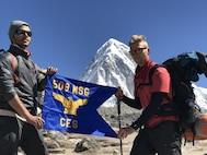 (From left) Airman 1st Class Anish Chauhan and Senior Airman Shane Hoag, both water and fuel systems management journeymen of the 509th Civil Engineer Squadron, stand with the squadron's guide-on flag at Mount Everest South Base Camp May 20, 2017. They hiked just over 17,500 feet in seven days to reach this base camp of the mountain. Senior Airman Sukh Bhandari, an aerospace ground equipment journeyman of the 509th Maintenance Squadron, also made the hike. (courtesy photo)