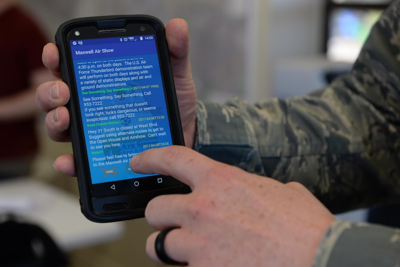 An Airman uses the Maxwell Airshow App, during the 2017 Maxwell Airshow on Maxwell Air Force Base, Ala., April 9, 2017. The app provided information about upcoming events and to lead participants to the various food and souvenier vendors. (U.S. Air Force photo/Senior Airman Tammie Ramsouer)