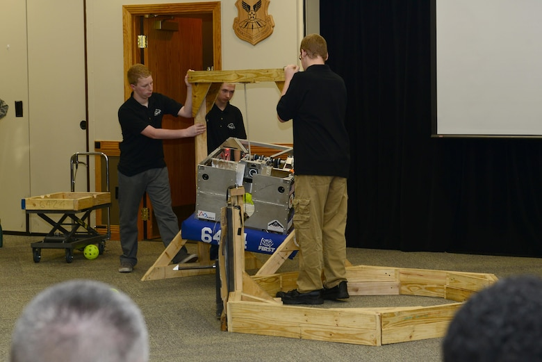 Members of the Knob Noster Stealth Panther Robotics Team, demonstrate how the team competes at Whiteman Air Force Base, Mo., June 14, 2017. This was the team's inaugural year, and they competed in multiple competitions including the Missouri State Competition and the World Championships in St. Louis, Missouri. (U.S. Air Force photo by Airman Taylor Phifer)