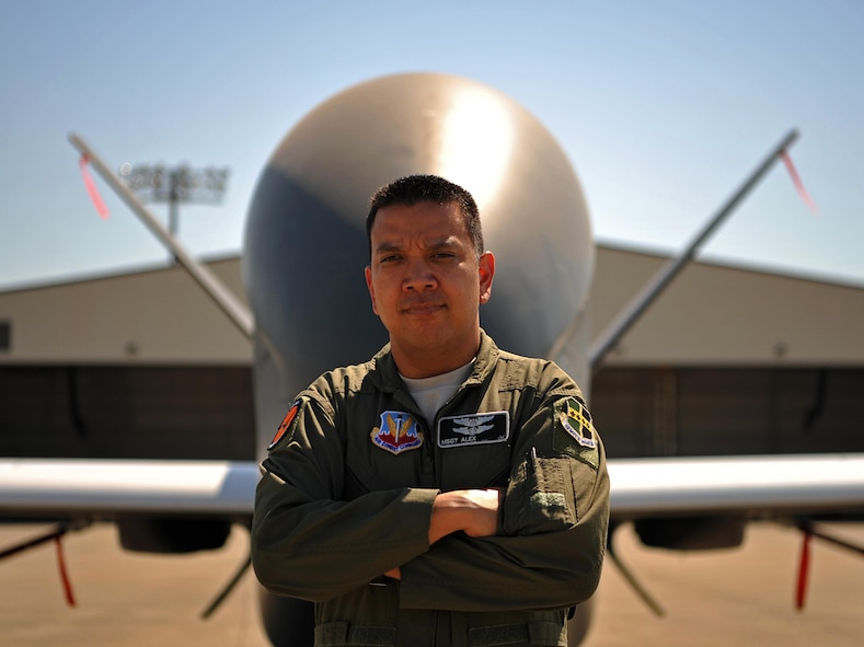 Master Sgt. Alex, 12th Reconnaissance Squadron student pilot, poses for a photo in front of a RQ-4 Global Hawk June 21, 2017 at Beale Air Force Base, California. Alex was previously a sensor operator on the RQ-4 who was stationed at Beale before going through all of the training to become a remotely piloted aircraft pilot. He has returned to Beale to finish his training to become an enlisted pilot and fly the RQ-4. (U.S. Air Force photo/Airman 1st Class Tristan D. Viglianco)