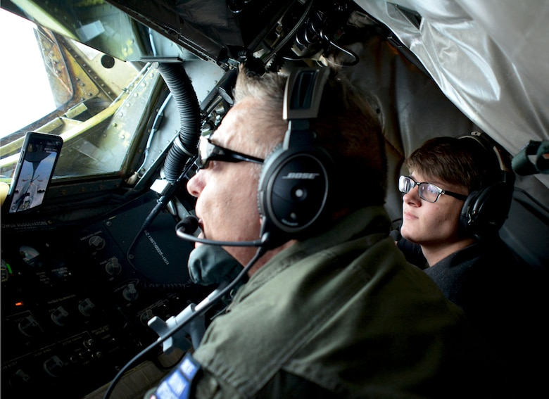Senior Master Sgt. Darby Perrin, 465th Air Refueling Squadron boom operator, demonstrates refueling a B-2 Spirit bomber to his son Garrett Perrin, an Organization of Black Aerospace Professionals student, while flying in a 507th Air Refueling Wing KC-135 Stratotanker here June 20, 2017. Twenty-seven young OBAP aviators observed how the Air Force Reserve directly fuels the fight through preparation, training and striving for combat-readiness during their three-hour long orientation flight. (U.S. Air Force photo/Staff Sgt. Samantha Mathison)