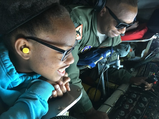 Tech. Sgt. Bobby Jackson, 465th Air Refueling Squadron boom operator, demonstrates refueling a B-2 Spirit bomber to Alexia Vence, an Organization of Black Aerospace Professionals student, while flying in a 507th Air Refueling Wing KC-135 Stratotanker here June 20, 2017. Twenty-seven young OBAP aviators observed how the Air Force Reserve directly fuels the fight through preparation, training and striving for combat-readiness during their three-hour long orientation flight. (U.S. Air Force photo/Staff Sgt. Samantha Mathison)