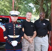 "U.S. Army Engineer Research and Development Center's Garsheo ""Gus"" Black (right) poses with Marines during ERDC's Corps Day.  Black, the ERDC Reachback Operations Center's Division Chief, was recently named the recipient of the 2016 Family Readiness Individual Excellence Award for his contributions as the ERDC Family Readiness Coordinator."