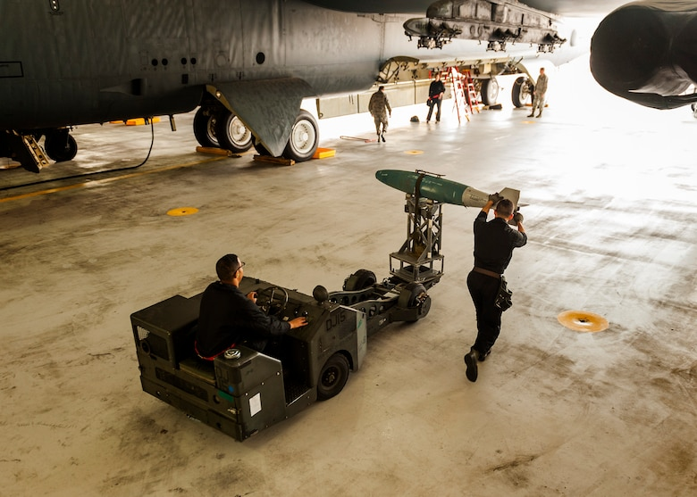 Airmen from the 5th Aircraft Maintenance Squadron Global Strike Challenge team transport an inert GBU-38 munition to a B-52H Stratofortress at Minot Air Force Base, N.D., June 19, 2017. During the competition, the four-member GSC team was evaluated and scored based on their speed, precision and bomb-loading expertise. (U.S. Air Force photo/Senior Airman J.T. Armstrong)