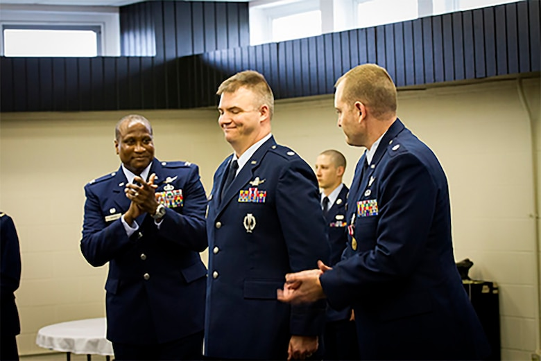 CAVALIER AIR FORCE STATION, ND -- Col. Devin Pepper, 21st Operations Group Commander, congratulates the inbound Commander of the 10th Space Warning Squadron, Lt Col Stephen Hobbs, at a change of command ceremony, June 23, 2017, at Cavalier Air Force Station, N.D.  The 10th SWS operates and maintains the world's most capable phased-array radar system at the Air Force's only CONUS Isolated installation.  The Perimeter Acquisition Radar Attack Characterization System continuously provides critical missile warning and space surveillance data to North American Aerospace Defense Command, United States Strategic Command, and regional combatant commanders.  PARCS monitors and tracks more than half of all earth-orbiting objects to enable space situational awareness and space control. (Courtesy photo)