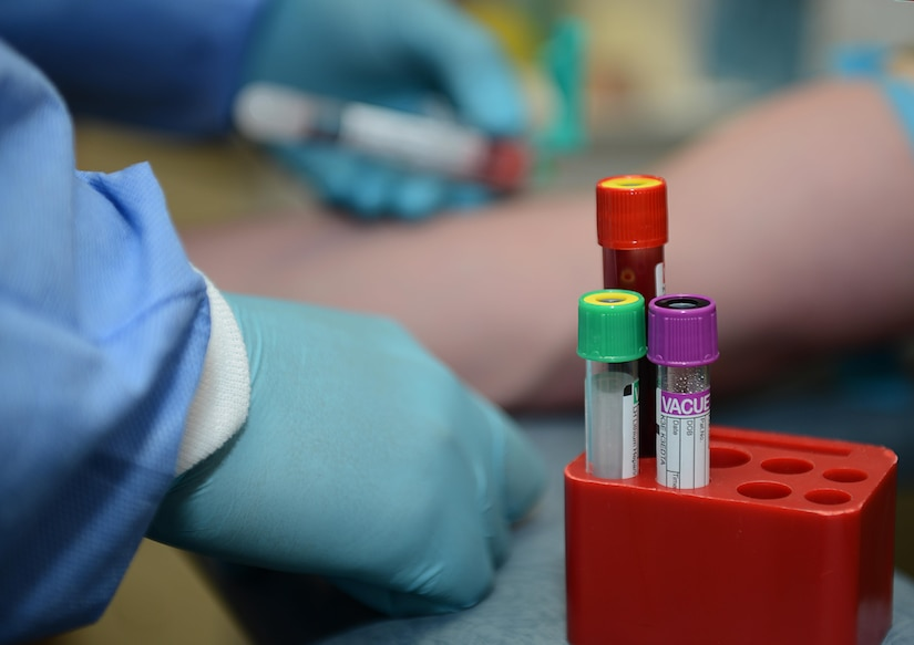 U.S. Army Spc. Juan Hernandez, Jr., McDonald Army Medical Center U.S. Army Medical Activity medical laboratory technician, draws a blood sample from a patient at Joint Base Langley-Eustis, Va., June 26, 2017. The JBLE lab technicians perform over a million tests annually and study the hematology, coagulation, chemistry and microbiology of the samples. (U.S. Air Force photo/Staff Sgt. Teresa J. Cleveland)