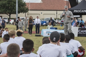 Col. Thomas Miner, 502nd Security and Readiness Group commander, speaks to children at a youth football camp June 26, 2017, at Joint Base San Antonio-Randolph. JBSA-Randolph was one of 11 military communities selected to host a 2017 ProCamps football event. (U.S. Air Force photo by Senior Airman Stormy Archer)