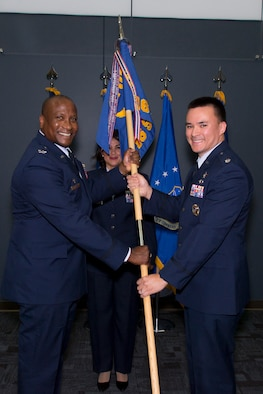 PETERSON AIR FORCE BASE, Colorado -- Col Devin Pepper, 21st Operations Group Commander, hands the 16th Space Control Squadron guidon to Lt Col Ernest Schmitt at a change of command ceremony, June 16, 2017, at Peterson Air Force Base, Colorado.  The 16th SPCS is Air Force Space Command's only defensive space control unit and is responsible for operating defensive space control capabilities to rapidly achieve flexible and versatile space superiority.  The unit draws Total Force manpower support from its Reserve Associate Unit, the 380th Space Control Squadron.  (Courtesy Photo)