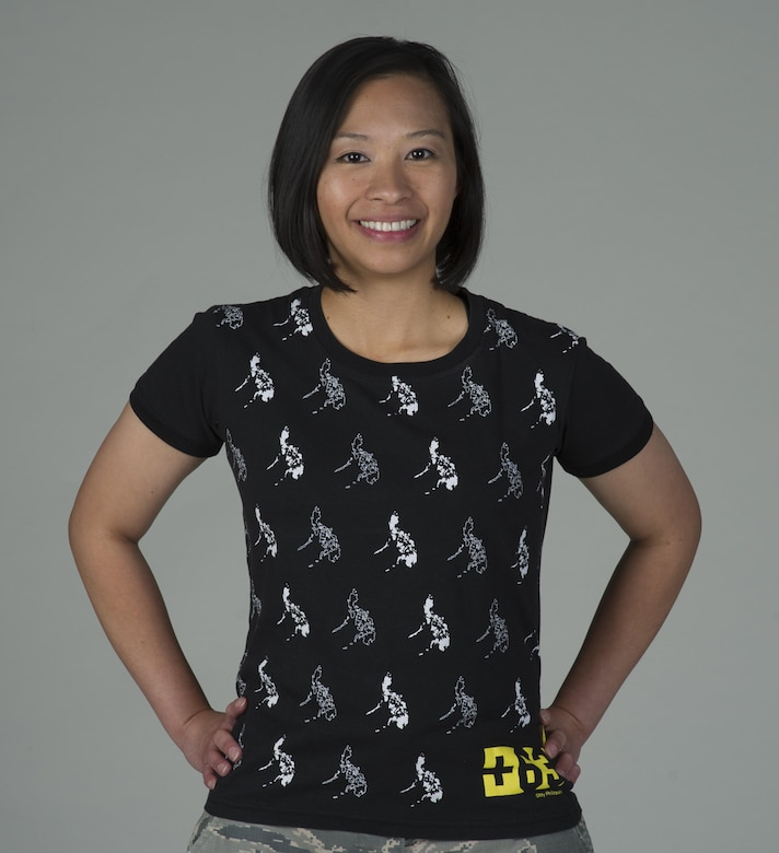 Staff Sgt. Jael Thomas, 60th Comptroller Squadron, poses for a photo June 9, 2017 at Travis Air Force Base, Calif., while wearing a shirt featuring images of the Philippines, her home country. Thomas joined the Air Force in October 2010. As a member of the 60th CPTS, she helps provide financial services to more than 12,000 people. (U.S. Air Force photo/ Heide Couch)