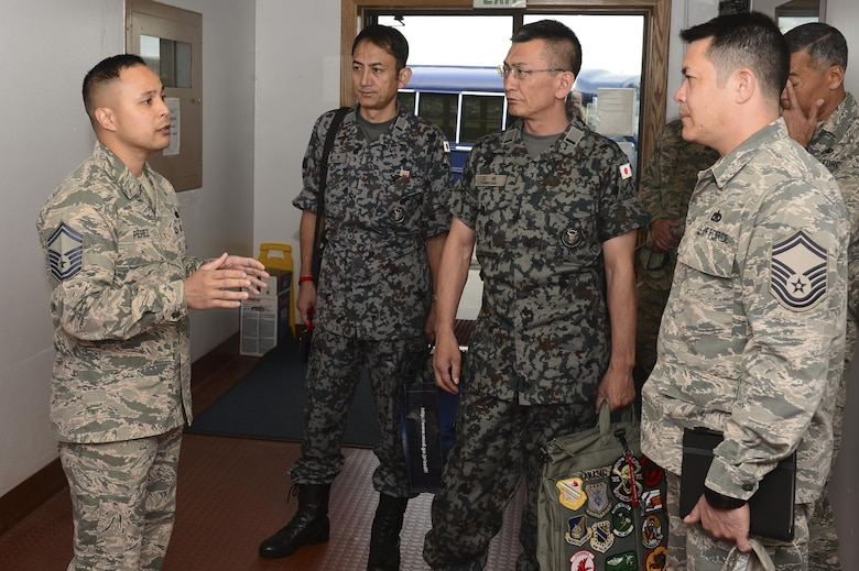 U.S. Air Force Senior Master Sgt. Franklin Perez, the Airman Leadership School (ALS) Commandant, speaks to Warrant Officer Katsumi Yamazaki, the Japan Air Self Defense Force senior enlisted advisor, about ALS, June 23, 2017, at Eielson Air Force Base, Alaska. During Yamazaki's tour, he visited ALS and the First Term Airmen Center where he learned how the Air Force grooms Airmen into non-commissioned officers. (U.S. Air Force photo by Airman 1st Class Isaac Johnson)
