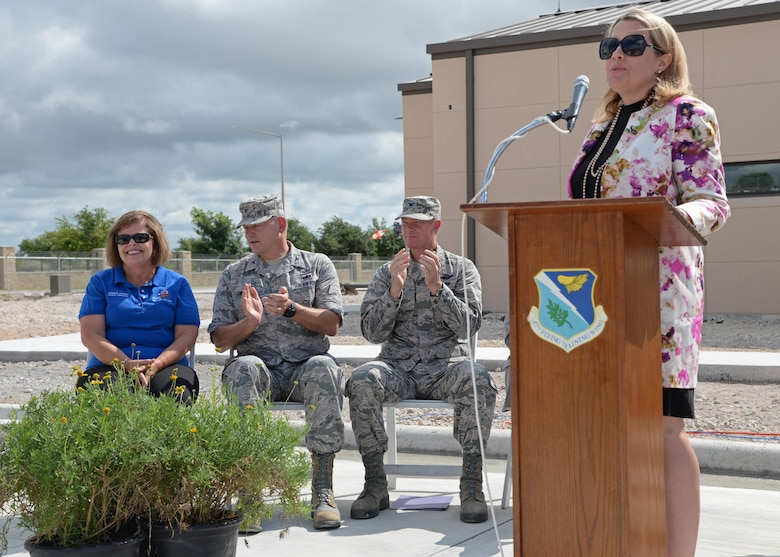 Mrs. Shannalea Taylor, Texas Military Preparedness Commission commissioner, gives a speech before the crowd gathered in front of the new Defense Control Center at Laughlin Air Force Base, Texas, June 26, 2017.  During her speech, Mrs. Taylor praised Col. Shank for his innovation and impact on making Laughlin a better base than when he found it.