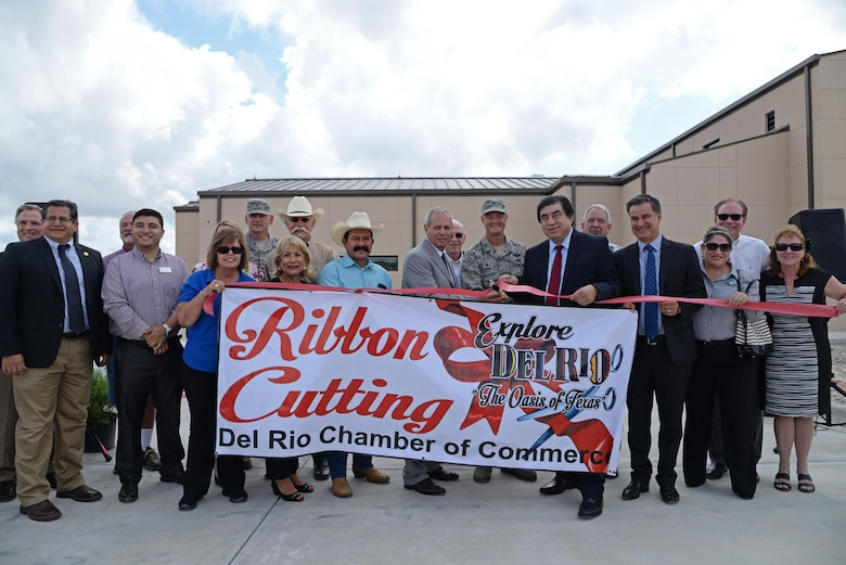 Members of Laughlin Air Force Base, the city of Del Rio, Val Verde County, and the state of Texas join together to cut the ribbon for the Defense Control Center at Laughlin AFB, Texas June 26, 2017.  The Defense Control Center, located outside the West Gate, will allow the base's security forces the ability to inspect vehicles with state-of-the-art technology, while ensuring the safety of the base's community.