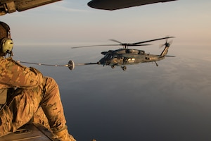 A U.S. Air Force loadmaster from the 353rd Special Operations Group observe a Japan Air Self-Defense Force UH-60J Black Hawk helicopter assigned to the Komatsu Air Rescue Squadron above the Sea of Japan, June 19, 2017, during Exercise Teck Jet. This is the first time that members of the 353rd SOG held HAAR training at night with JASDF members in Honshu Island in Japan. Exercise Teck Jet is a joint combined exchange training (JCET) focused on improving interoperability between U.S. Air Force and Japan Air Self-Defense Force.