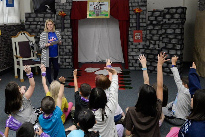 Children participate in story telling during Yokota's annual Vacation Bible School at Yokota Air Base, Japan, June 23, 2017. Approximately 150 children attended the VBS where they participated in various activities such as arts and crafts, storytelling and snack time. The chapel was decorated to represent a medieval castle for the theme of 'Mighty Fortress'.